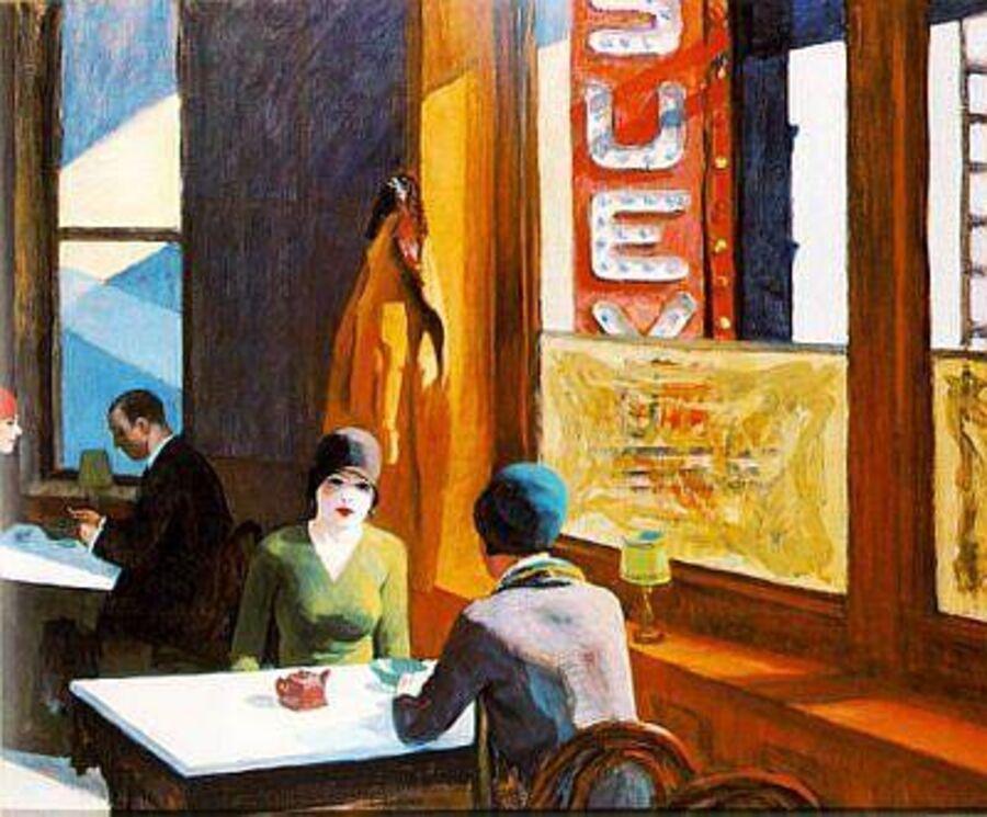 To kvinder sidder på en café